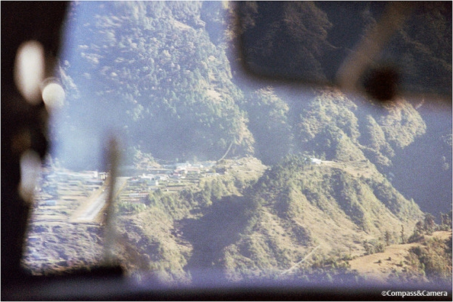 The Lukla landing strip (lower left) as seen through the plane's front window