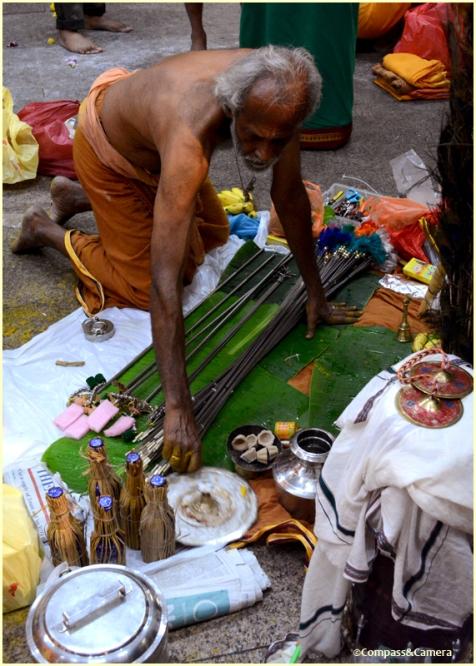 Arranging his wares