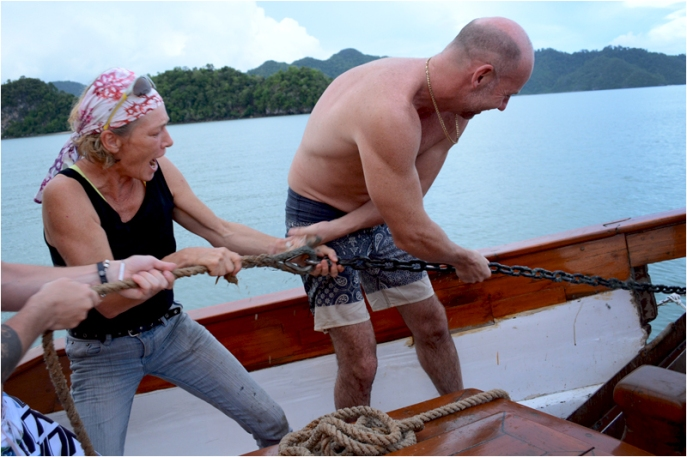 Eva puts some muscle into pulling up the anchor