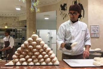 Stacking meringues at Aux Merveilleux de Fred