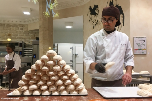 Stacking meringues at Aux Merveilleux de Fred