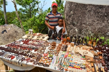 Father and son selling handmade jewelry